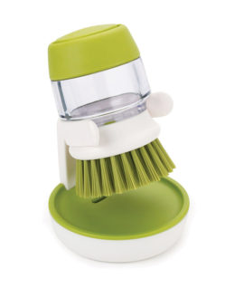 Soap Dispensing Palm Brush with Storage Stand Soap Dispensing Palm Brush with Storage Stand. Streamline your sink with this neat, compact design. This sturdy palm-held washing-up brush features an easy-fill washing-up liquid reservoir that dispenses the required amount of soap with a simple push of the top button. Its compact size makes it easy to control and ideal for cleaning pots, pans and dishes. The brush has its own convenient storage stand that allows it to drip dry hygienically and the whole thing dismantles for easy cleaning. KEY FEATURES Compact scrubbing brush with non-scratch bristles ideal for pots, pans and dishes Integrated, easy-to-fill reservoir for washing up liquid Simply push button to release correct amount of washing up liquid Sturdy storage stand allows brush to drip dry naturally Dismantles for easy cleaning AMAZON TOP Customer Reviews 5.0 out of 5 starsGreat ByMyrtson November 15, 2017 Verified Purchase Love it, does what it says. I also like that the brush heads are replaceable. Comment|Was this review helpful to you? Yes No Report abuse 5.0 out of 5 starsThe holder is the best part. If it weren't for the little stand ByKenon November 10, 2016 Verified Purchase It is exactly as described, and it works well. The holder is the best part. If it weren't for the little stand, I would go back to a longer handled brush. Comment|Was this review helpful to you? Yes No Report abuse 5.0 out of 5 starsLove it! ByWest's Coaston January 27, 2018 I bought this for my sister for Christmas as she was using a travel size soap dispenser previously. She immediately set it up and got rid of the other. Our mother immediately said I want two..works really well and if you push the end soap spits out so I use it when I need to wash my hands too it doesn't just need to dispense when wet or washing. We haven't had any leaking soap issues like previously reviews have mentioned.