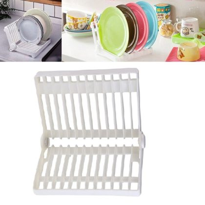 """Foldable Mini Dish Drip Rack Drainer & Plate Holder Foldable Mini Dish Drip Rack Drainer & Plate Holder. The Flexible and Portable nature of this Dish Rack makes it an essential dinnerware to own. It is foldable and can hold your precious dinner plates and dishes. Extremely handy to use, it can stand neatly on kitchen shelves, cupboards, counter tops, dinner tables, and any place where you require it to be. It can fold flat to keep cups, glasses, saucers, bowls and other glass or ceramic crockery. Easy to clean and simple to use, it is made from high quality food-grade plastic. KEY FEATURES 1.Easy to Fold, It Holds Dinner Plates and Ceramic Dishes Neatly and Safely. 2.Flexible and Portable, It Can Sit Neatly on Kitchen Shelves, Countertops, Dinner Tables, Cupboards. 3.Folds Flat to Keep Cups, Glasses, Bowls and Other Crockery Items. 4.Easy to Clean and Simple to Use, It Is Made from High Quality Food-Grade Plastic. 5.When the drip rack is folded, more than ten cups or beer glass can be dry soon on it. 6.Look, when it is unfolded, dishes are quickly dry and clean over it. Specifications: Material:ABS Color:White Weight:255g Open Size:21 X 18 X 16cm Fold Size:18 X 21.6 X 7cm Capacity:Load 12 dishes Inside the box:1 Dish Rack Note:The color may vary due to your monitor screen settings. However the product is same as shown in the image. 100% SATISFACTION GUARANTEED.Quality environmentally friendly materials, safety and health.Sturdy plastic """"V"""" design provides plenty of air-drying space, and folds flat for easy storage.Easy to clean. Just put the rack in the dishwasher to keep it bacteria free.You Will Receive: 1x Folding Dish Rack Sympathetically Tip : It would be ideal if you be reminded that due lighting impacts, screen's splendor/differentiate settings and so on, there could be some slight contrasts in the shading tone of the site's photograph and the genuine thing.Thing Measure by hand, it could be 0.5-1cm unique. trust you can understanding, will be earnestly valu"""